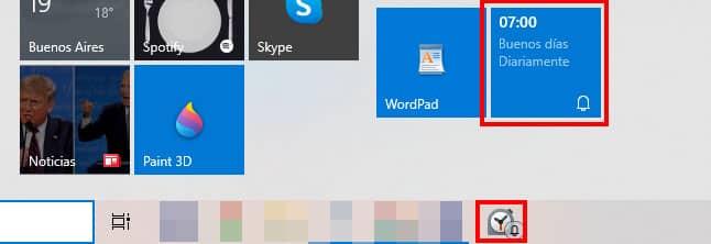 como añadir reloj en barra de tareas windows
